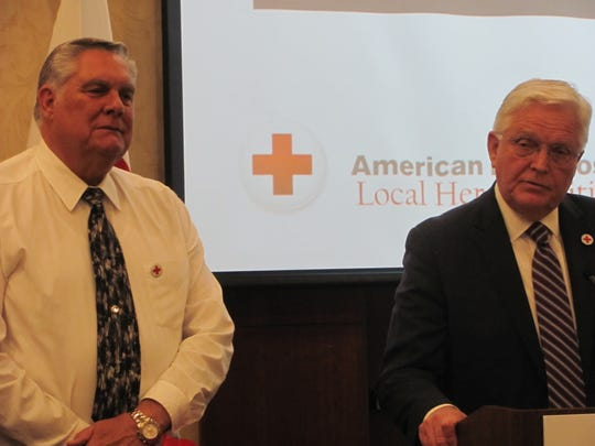 State Rep. Lowry Snow, right, talks about retired Kane County Sheriff Lamont Smith's example during the annual American Red Cross tribute to community heroes event Thursday in St. George.