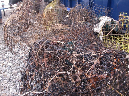 Discarded crab traps that were retrieved from Barnegat Bay in Waretown. Efforts are under way around the world country to remove discarded fishing equipment from waterways, where it can kill marine animals and present a hazard to navigation.