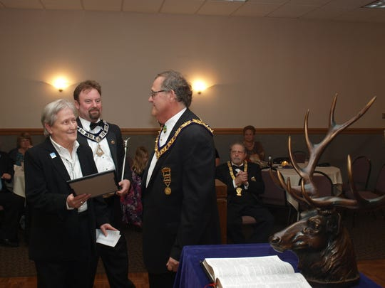Suzanne Lucas, past auxiliary president and special-needs chairperson for the Flemington Elks, was honored recently by the lodge for raising $15,225 for special-needs causes. Presenting the award is Exalted Ruler Rich Lavagno while officer JD Harvis looks on.