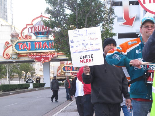 In this Oct. 24, 2014 photo, casino workers picket