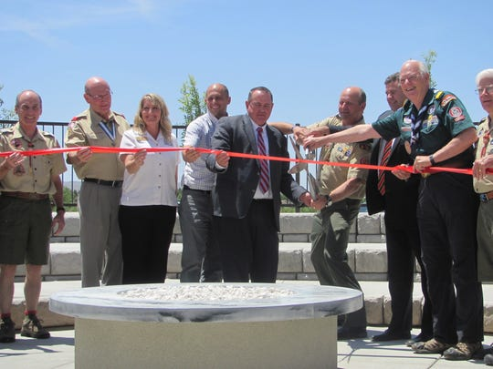Boy Scout and community dignitaries pose for a ribbon-cutting ceremony Tuesday at the Marion D. Hanks Scout Camp at Quail Creek in Hurricane.