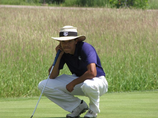 Lakeview's Andrew Walker lines up a putt during the