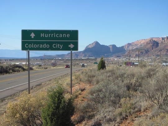 Traffic passes stateline polygamous community Colorado
