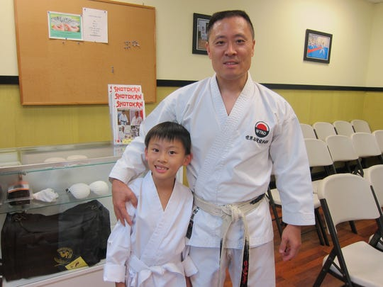 Lance Jeremiah Lim with Sensei Sonny Kim during his first day at Karate-Do dojo in Symmes Township.