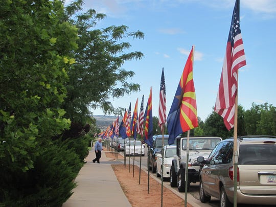 Flags line the street in front of Masada Charter School in Centennial Park, where residents gathered for Fourth of July festivities south of Colorado City on Saturday.