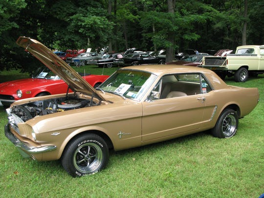 A 1965 Ford Mustang was one of hundreds of cars on display Sunday during the 11th Annual David Hill Memorial Locust Grove Car Show in Poughkeepsie.