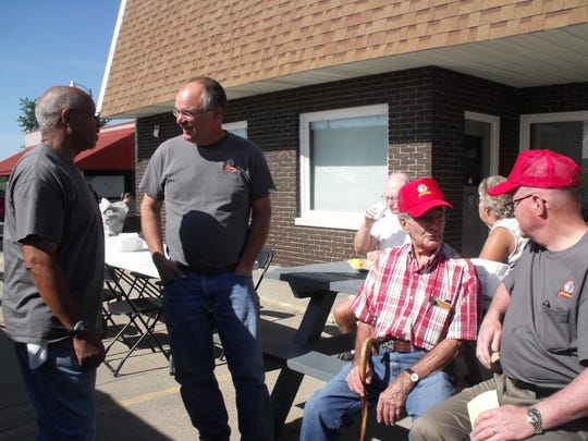 During the annual Mishler's customer appreciation weekend, past and present owners and employees came together. Current owner Mike Monson visits with the manager of the new Sturgis shop Nick King while Paul Mishler and Sales Manager Roger Penrose talk.