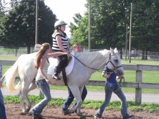 Sarah experiences the joy of riding a horse at the