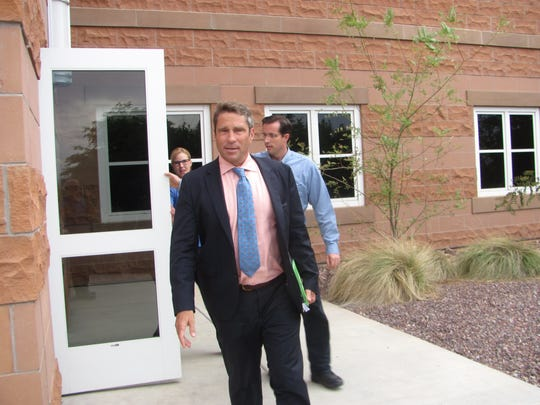 Defense attorney Scott Williams, followed by food stamp