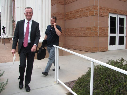 Washington County Attorney Brock Belnap smiles after