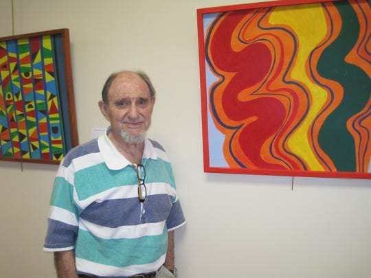Carl Rantz stands with one of his works in an exhibit on display through Oct. 31 at the Emerson Center's Foyer Gallery in Vero Beach.
