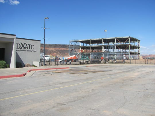 Construction crews work on new metal structures that will expand Dixie Applied Technology College's campus in this Sept. 23, 2016 file photo. The two adjacent buildings are expected to be completed by October.