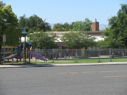 Children play on the grounds of East Elementary on Friday, Sept. 23, 2016. The downtown school is expected to be delivered to Dixie State University early next year once construction on the new Legacy Elementary is completed on 100 South.