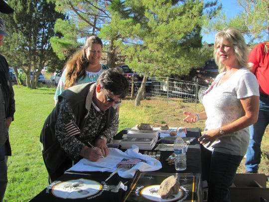 Jeanette Finicum, right, talks with well-wishers during a fundraiser for Bunkerville's Bundy family members held at the Veyo Park on Saturday. While Cliven Bundy and his sons face federal trials stemming from a pair of armed rebellion incidents the Bundys allegedly helped orchestrate against the government, the visitors expressed condolences to Finicum, whose Arizona Strip rancher husband was killed in a showdown with law enforcement during one of the incidents.