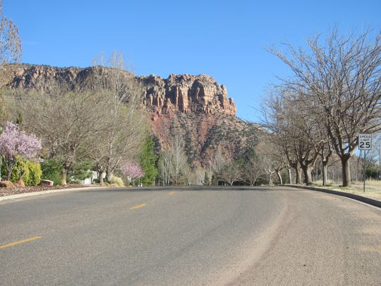 Vermillion-colored cliffs rise above Hildale Street