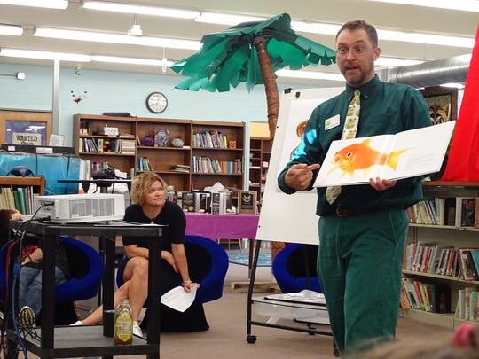 Literacy coach Wendy Wilging looks on as author and