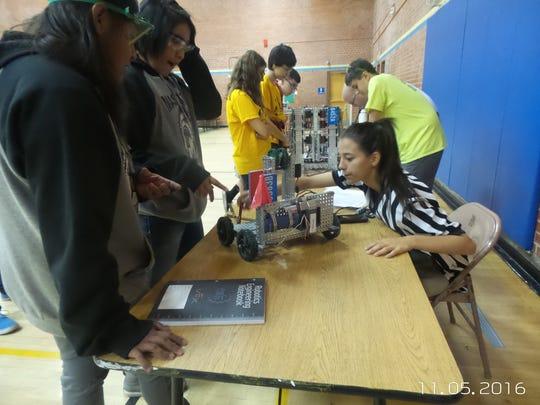 Mescalero Apache School students, l-r, Elizabeth Tsinnijinnie
