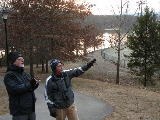 Mark Armstrong, left, and Warren Bielenberg spot birds during a Christmas Bird Count at Lakeshore Park. Counts are conducted each year around Christmas time in order to determine changes in bird population over time.