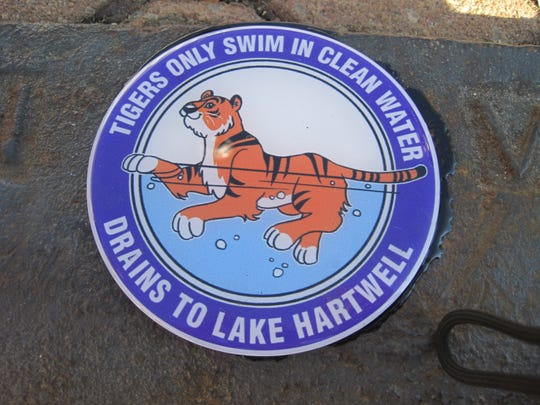 Customized stormwater drain markers were installed in downtown Clemson on Friday.