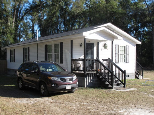 This Friday, Jan. 13, 2017 photo, shows the exterior of a home in Walterboro, S.C. where Gloria Williams lived for years with a girl that authorities say was kidnapped as an infant 18 years ago from a hospital in Florida. Williams was arrested and charged with kidnapping and interference with custody. (AP Photo/Russ Bynum)