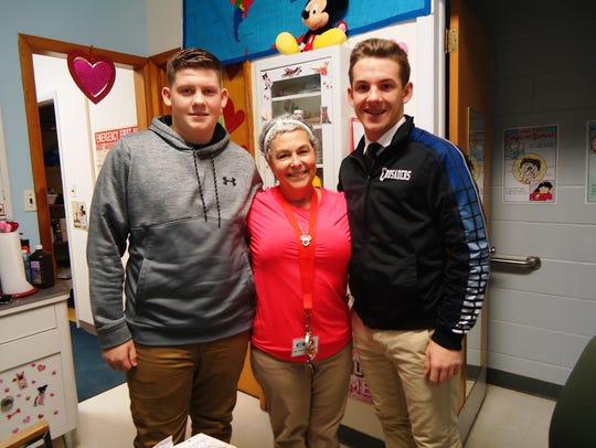 Deborah Papperman (center), school nurse, Cumberland