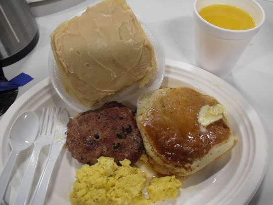 The fundraiser breakfast included grilled sausage patties, scrambled eggs, pancakes with real maple syrup, homemade sweet rolls and juice or coffee.
