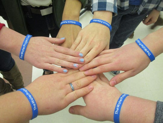 Those participating in the Water Challenge wear blue
