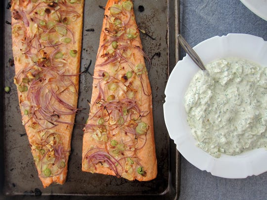 This roast salmon is served with a fennel yogurt sauce.