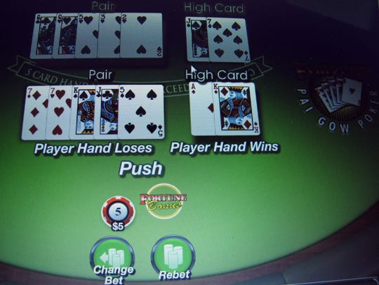 A game of Texas Hold 'Em is under way on a computer screen in Atlantic City.