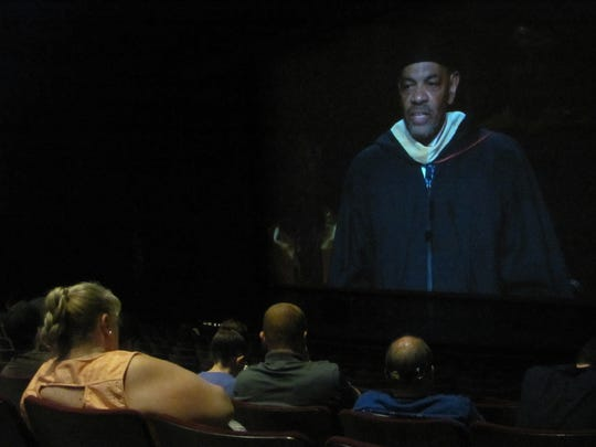 Former NBA All-Star and pro basketball coach Lionel Hollins appears on a screen in front of a Cox Auditorium overflow crowd attending Dixie State University's commencement exercises Friday, May 4, 2017. The university presented 1,785 degrees to 1,699 students. Nearly half -- 42.8 percent -- of the degrees were baccalaureates, a sign the university is continuing to develop more four-year degree options.