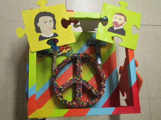 """As part of their problem's solution, STEM Institute students created a """"Peace-Tree-T,"""" using their concept of """"reverse art"""" for the Odyssey of the Mind competition."""