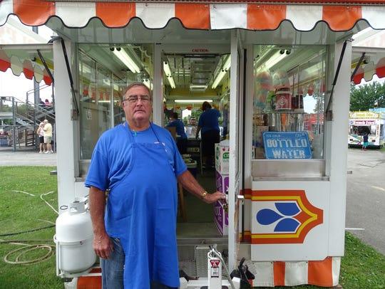 Doug Guinsler has been selling popcorn, caramel apples