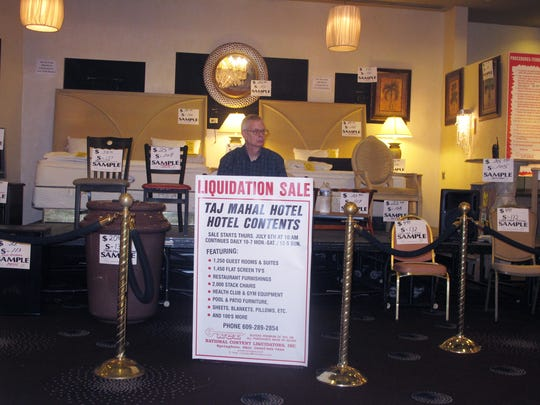An employee of a liquidation company waits for customers at the former Trump Taj Mahal casino in Atlantic City N.J. on Thursday July 6, 2017 moments before a sale of the casino hotel's contents begins.