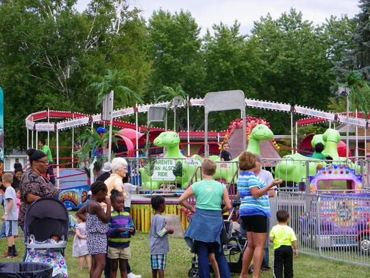 A packed crowd enjoyed rides, games, food and live