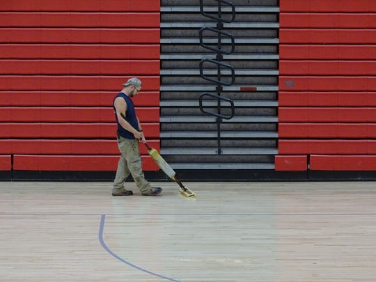 Harding High School is refinishing its basketball court