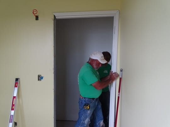 Gene Hay, of Kingdom Builders and Remodeling, installs