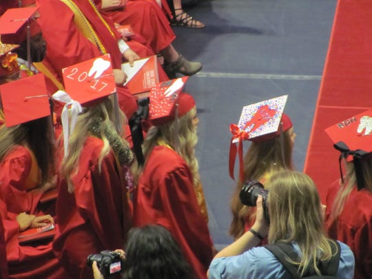 Dixie State University dental hygiene students prepare to receive their diplomas during May 2017 commencement exercises.