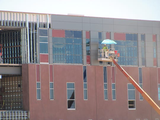 A construction worker at Crimson Cliffs Middle School