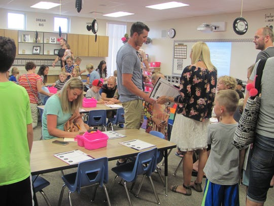 New students and their parents explore the Mrs. Fordham