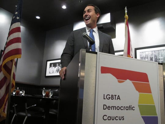 Businessman and gubernatorial candidate Chris King talks to a group of gay and lesbian Democrats in Tallahassee on Saturday.