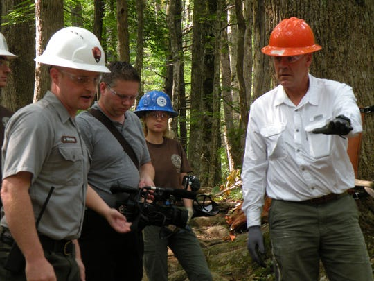 U.S. Interior Secretary Ryan Zinke, right, talks with rangers about trail improvements underway at Rainbow Falls Trail in the Great Smoky Mountains National Park.