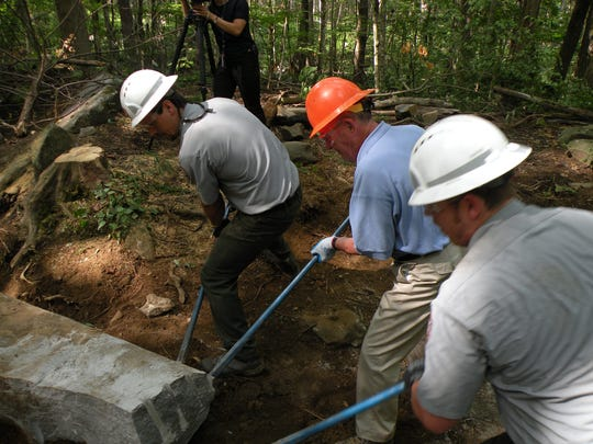 Sen. Lamar Alexander, center, helps work on Rainbow Falls Trail in the Great Smoky Mountains National Park.