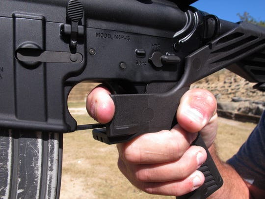 "This AR-15 rifle is fitted with a ""bump stock."" The stock uses the recoil of the semi-automatic rifle to let the finger ""bump"" the trigger, making it different from a fully automatic machine gun."