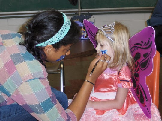 Face painting at the 2016 New Berlin Recreation Halloween Party.