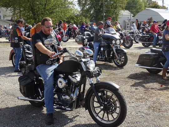 Participants of the Marion Area Harley Riders Association's annual Toy Run rest at a parking lot across the street from the restaurant Coonies, in the village of LaRue, Saturday afternoon.
