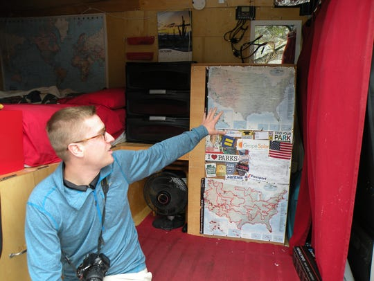 Mikah Meyer points to the map in his van that he uses