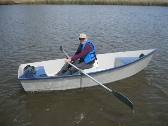 Jim Peck rows a boat on the South River about 6 miles