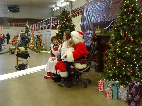 Santa Claus and Mrs. Claus took pictures with Kenzie
