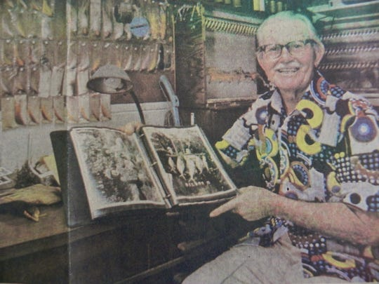 This picture of Capt. Bill Smith, taken in 1979, shows Smith at his fly tying table at his home in Islamorada.