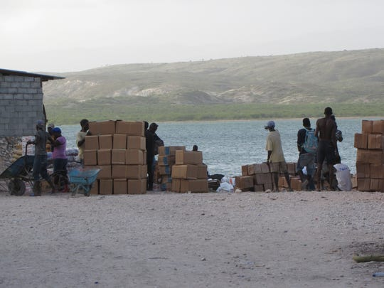 Haitian merchants prepare boxes of eggs from the Dominican